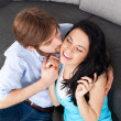 Young couple kiss on couch — Stock Photo #31742621