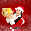 Christmas santa girl hold gift box present — Stock Photo