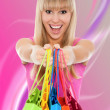 Woman with colorful shopping bags in her hands — Stockfoto