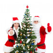 Santa Claus and christmas girl hold gift — Stock Photo