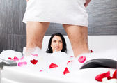 Young couple foreplay lying in jacuzzi — Stock Photo