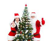 Noel baba ve noel kız hediye tutun — Stok fotoğraf
