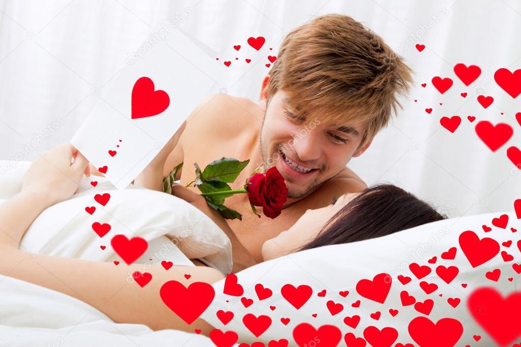 love valentine day couple lying in bed stock photo