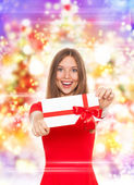 Happy girl hold red gift card — Stock Photo