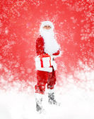 Santa Claus hold present gift box full length portrait — Stock Photo