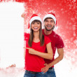 Christmas couple point finger white board — Stock Photo