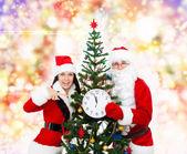 Santa Claus christmas girl hold clock — Stock Photo
