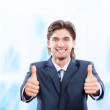 Young business man hold hand with thumb up gesture — Stock Photo