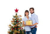 Coppia felice vacanza di Natale, anno nuovo decorato albero — Foto Stock