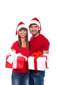 Christmas holiday happy couple hold present — Stock Photo
