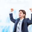 Successful excited business man happy smile hold fists up gesture in bright blue office — Stock Photo