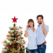 Christmas holiday happy couple, new year decorated tree — Stock Photo