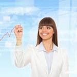 Business woman draw finance chart — Stock Photo