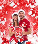 Christmas holiday happy couple hold tablet pad — Stock Photo