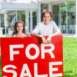 Kids hold for sale sign — Stock Photo