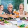 Big generation family drink orange juice — Stock Photo #41744385