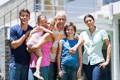 Smiling family outside — Stock Photo