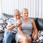 Senior couple watching tv — Stock Photo #43554539