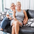 Senior couple watching tv — Stock Photo #43554545