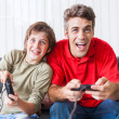 Father and son playing video game — Stock Photo #43555233