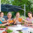 Family drink juice — Stock Photo #43555559