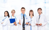 Medical team making welcome gesture — Stock Photo
