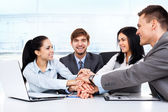 Business people holding pile of hands — Stock Photo