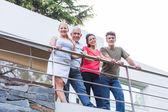 Family standing on terrace balcony — Stock Photo