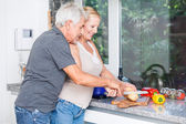 Senior couple cooking in kitchen — Stock Photo