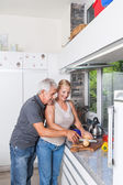 Senior couple cooking in kitchen — Stock Photo