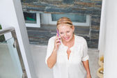 Senior woman talking on cell phone — Stock Photo