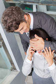 Businessman covering  woman eyes — Stock Photo