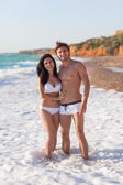 Woman and man on beach — Stock Photo
