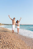 Couple with raised arms — Stock Photo