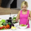 Woman mixing a salad — Stock Video #43552479