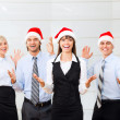 Businesspeople in santa hat — Stock Photo