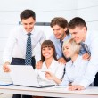 Business people looking to laptop screen — Stock Photo #43566531