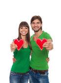 Couple holding heart shapes — Stock Photo