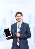 Business man holds tablet — Stock Photo