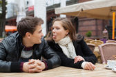 Woman Teasing Man While Sitting At Outdoor Restaurant — Stock Photo