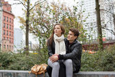 Couple Looking Away While Sitting On Parapet — Stock Photo