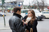 Couple In Jackets Communicating On Street Side — Stock Photo