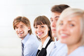 Business people sitting in row — Stock Photo