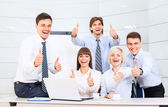 Business people hold thumb up — Stock Photo
