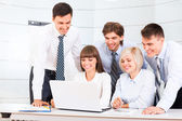 Business people looking to laptop screen — Stock Photo