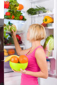 Woman holds fruits — Stock Photo