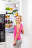 Woman open refrigerator door — Stock Photo