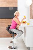 Woman drink orange juice — Stock Photo