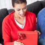 Woman opening present — Stock Photo #51025371