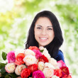 Beautiful woman with big roses — Stock Photo #51024257